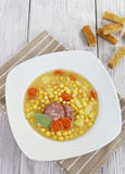 Pea soup with smoked sausage Stock Images