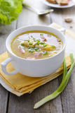 Pea soup with smoked sausages Royalty Free Stock Photos