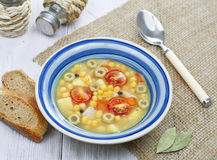 Pea soup with tomatoes and olives Royalty Free Stock Photography