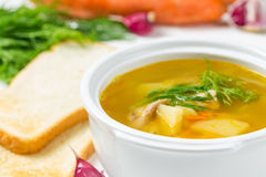 Pea soup in a tureen and bread Stock Photo