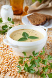 Pea soup in a white bowl Stock Photo