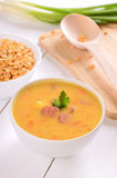 Pea soup on wooden table Stock Photography