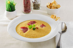 Pea soup. Yellow pea soup with bacon Stock Image
