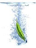 Pea splash Stock Images