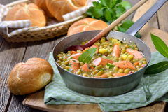 Pea stew with sausages Royalty Free Stock Image