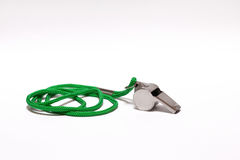 Pea whistle with a green string on white backgroun Royalty Free Stock Photos