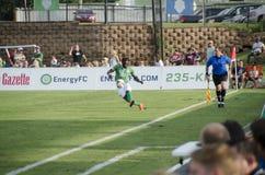 Peabo Doue kicking soccer ball Stock Photo