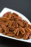 Peacans in a contempory bowl. Pecans whole in a contempory bowl Royalty Free Stock Images