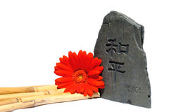 Peace. Decorative Peace rock/sculpture with bamboo and fower Royalty Free Stock Photo