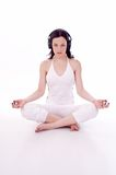 Peace. Girl with head phones practice yoga Stock Photography