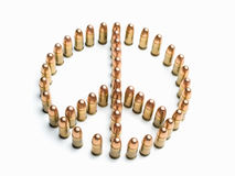 Peace. Symbol formed by bullets over white background, useful for  ,war,terrorism,military and similar themes Royalty Free Stock Images