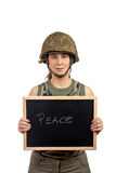 Peace. A beautiful soldier girl holding the chalkboard with peace word Royalty Free Stock Photo