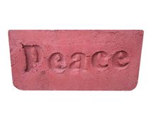 Peace. The word peace carved into a brick Stock Photography