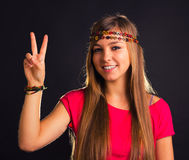 Peace. Cute girl with peace sign Royalty Free Stock Photos