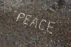 Peace. Word on the pebbles Stock Photos
