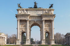 Peace arch, Sempione park and Sforzesco Castle in Milan. The Peace arch, also known as Porta Sempione, with Sforzesco Castle in the background Royalty Free Stock Photography