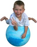 Peace on a ball. Boy laying on a large blue ball smiling and holding up a peace sign stock images