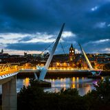 Peace bridge in Derry Londonderry in Northern Ireland with city center Royalty Free Stock Image