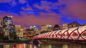 Peace Bridge over Bow River in Calgary, Canada stock video footage