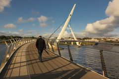 The Peace Bridge. Derry Londonderry. Northern Ireland. United Kingdom. The Peace Bridge over the river Foyle. Derry Londonderry. Northern Ireland. United Kingdom stock photo