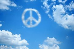 Peace Cloud. A peace sign cloud floats among other normal clouds in the sky Royalty Free Stock Photography