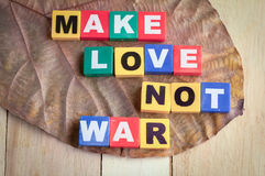 Peace concept with text box words make love not war inside Royalty Free Stock Photos