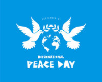 Peace Day. September 21. International Day of Peace. September 21. Two pigeons with an olive branch and a globe. Vector illustration on a blue background Royalty Free Stock Images