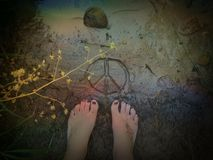 Peace and dirty feet Royalty Free Stock Photo