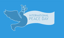 Peace dove with olive branch and banner for International Peace Day poster Stock Photo