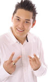 Peace dude. Asian man showing peace dude sign Stock Photography