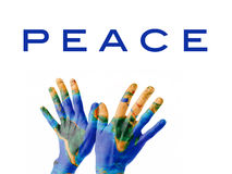 Peace on Earth. A pair of hands on a bird-kind position, painted as the Earth planet and symbolizing Peace on Earth. Image of the world map is courtesy of NASA stock images