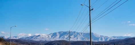 Peace on earth. Lovely snowy smoky mountians Stock Photography