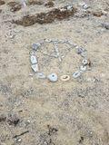 Peace on earth. Peace sigh made out of rocks and sand on the beach Royalty Free Stock Images