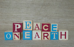 Peace on Earth Spelled with Wood Blocks Stock Photo