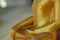 Peace, elegance and serenity. Golden statue in meditation position Royalty Free Stock Images