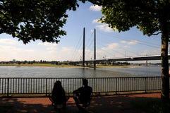 Peace on the Embankment Rhine in Düsseldorf. Embankment of the Rhine river in Dusseldorf Stock Image
