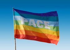 Peace flag. Flutters in the blu sky Royalty Free Stock Images