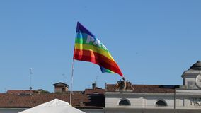 Peace flag on the sky in a european city. Peace flag in the wind, Italian city, video without audio stock footage