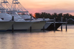 A peaceful sunset in Southern Florida - a marina. A beautiful sunset and yachts in Florida royalty free stock image