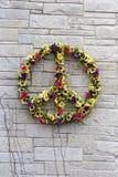 Peace Flower Wreath. On a brick wall Stock Photos