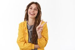 Peace friends. Cheerful enthusiastic gorgeous girl curly chestnut hairstyle show victory gesture smiling laughing royalty free stock photos