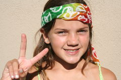 Peace Girl. Young girl with a peace sign bandanna around her head Royalty Free Stock Images