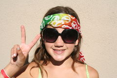 Peace Girl with Sunglasses. Young girl with a peace sign bandanna around her head Royalty Free Stock Image