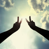 Peace hand gesture in sky. Hand with two fingers show peace Stock Photos