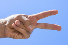 Peace hand sign Stock Photo