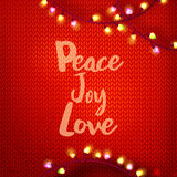 Peace Joy Love on red kniting Royalty Free Stock Images