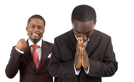 Peace and Joyful Business. This is an image of two businessmen one is praying peacefully and the other is joyful. This image can be used to represnt Peace and Royalty Free Stock Photo