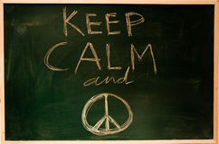 Peace. Keep calm and Peace. Peace and understanding messages on a children blackboard. Innocence and good thinking Stock Image