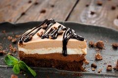 Peace of layered sweet chocolate souffle dessert Stock Photos