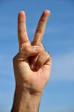 Peace and love!. This picture represents the hand of a man showing two fingers up in sign of peace and love or victory stock images
